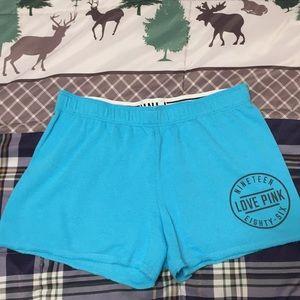 Victoria's Secret PINK, baby blue shorts.
